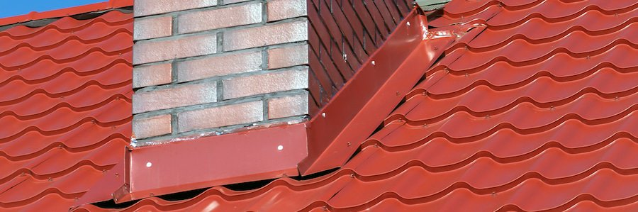 roof flashing around a brick chimney on a metal roof - Metal Roof Flashing